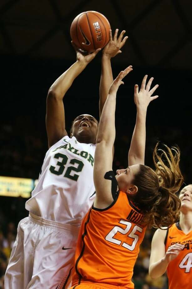 Baylor's Brittney Griner s hoots over Oklahoma State in the Lady Bears' 83-49 rout. Photo: Michael Bancale