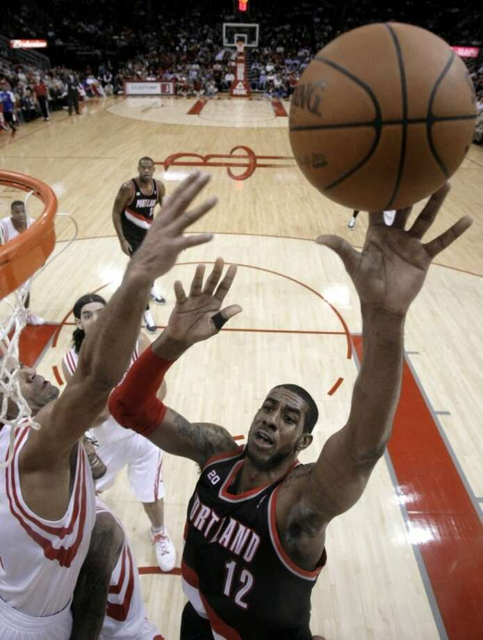 The Portland Trail Blazers' LaMarcus Aldridge shoots as the Houston Rockets' Shane Battier defends during the fourth quarter of Wednesday's game in Houston.
