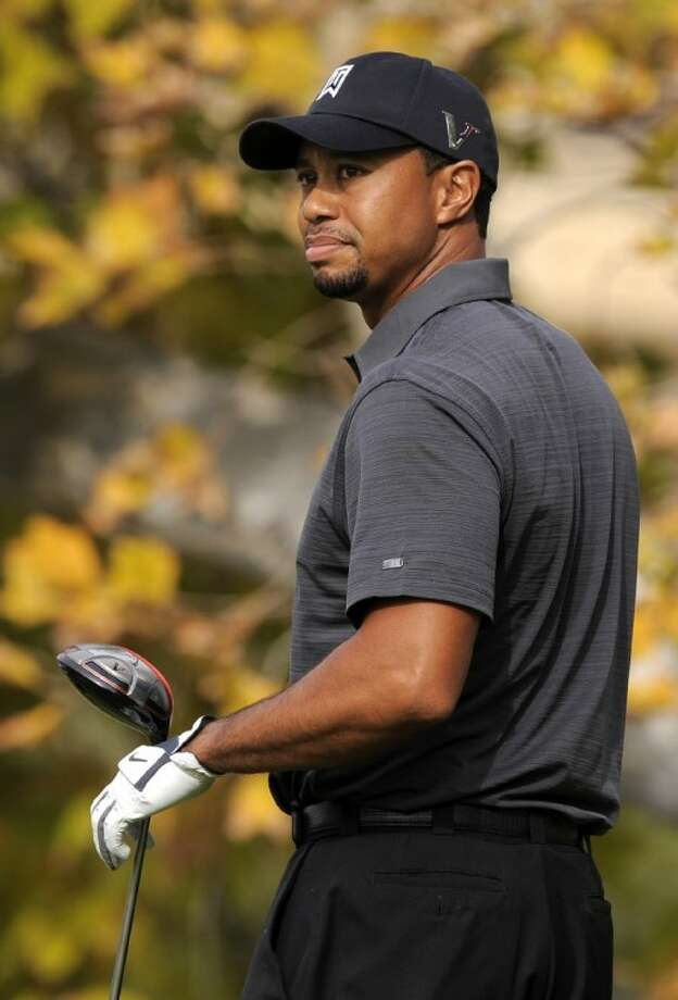 Tiger Woods looks on after teeing off on the fifth hole during the second round of the Chevron World Challenge at Sherwood Country Club in Thousand Oaks, Calif., on Dec. 3.
