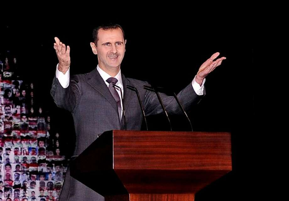 In this photo released by the Syrian official news agency SANA, Syrian President Bashar Assad gestures as speaks at the Opera House in central Damascus, Syria, Sunday, Jan. 6, 2013. Syrian President Bashar Assad on Sunday outlined a new peace initiative that includes a national reconciliation conference and a new government and constitution but demanded regional and Western countries stop funding and arming rebels first. Photo: HOPD