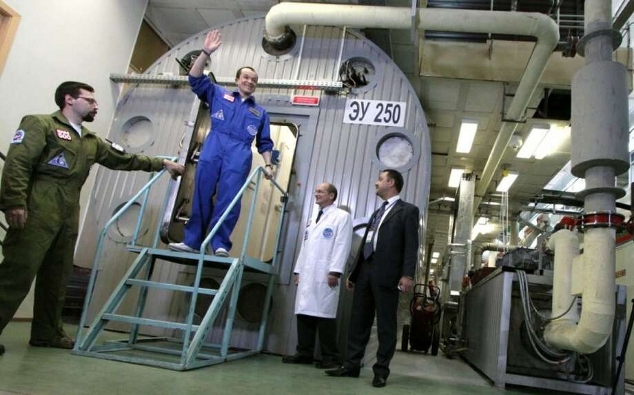 This Nov. 4, 2011 file photo shows researcher Sukhrob Kamolov leaving a set of windowless modules after a grueling 520-day simulation of a flight to Mars. Astronauts have a down-to-Earth problem that could be even worse on a long trip to Mars: They can't get enough sleep. Photo: Oleg Voloshin