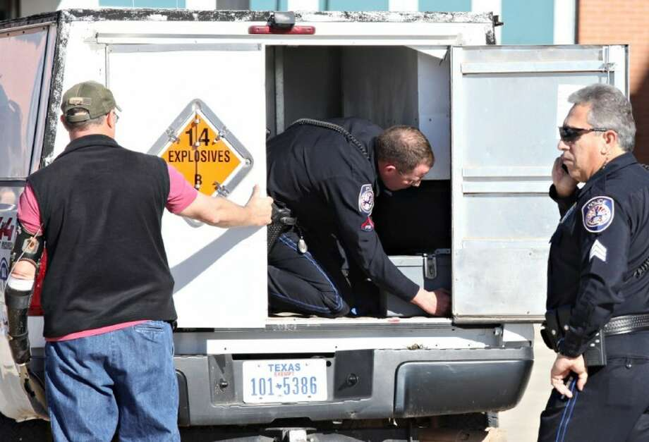 Patrol Officer and Explosive Ordnance Technician Dylan Hale, center, secures an explosives transport box containing military-grade explosives to the back of a vehicle, Saturday, Dec. 31 at the Midland International Airport in Midland, Texas. The explosives, confiscated from a departing passenger, will be taken to a storage facility. Photo: Heather Leiphart