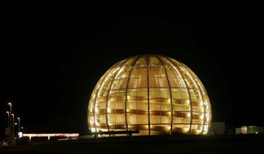 """This 2010 file photo shows the globe of the European Organization for Nuclear Research, CERN. The world's most powerful atom smasher goes into a 2-year hibernation in 2013, aiming to reach maximum energy levels that may lead to the so-called """"God particle."""" Photo: Anja Niedringhaus"""