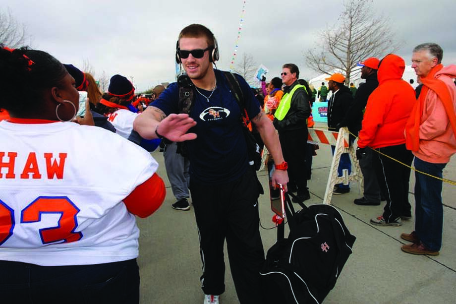 Sam Houston State University receiver Trey Diller, a College Park High School graduate, greets Bearkat fans that were lined up when the team got off the bus Saturday morning at FC Dallas Stadium in Frisco for the FCS national championship game.