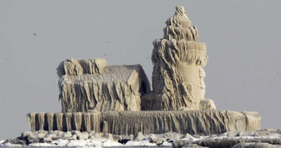 Thick ice coats the lighthouse at the entrance to Cleveland harbor late last week.