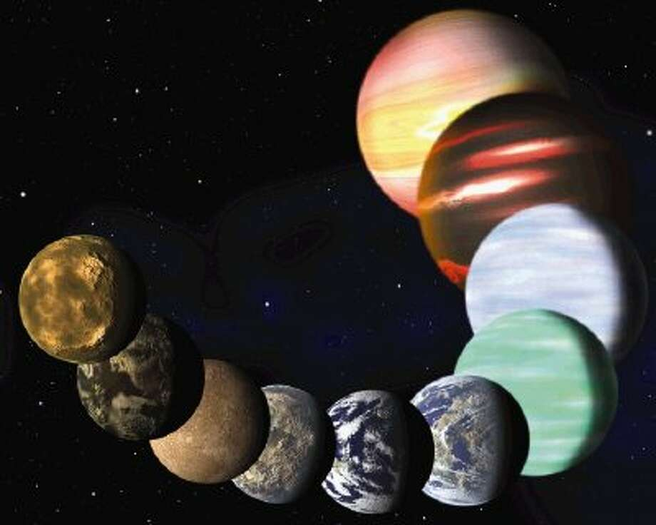 This artist rendering released Monday by Harvard-Smithsonian Center for Astrophysics shows the different types of planets in our Milky Way galaxy detected by NASA's Kepler spacecraft. A new analysis of Kepler data found there are at least 17 billion planets the size of Earth. / AP2013