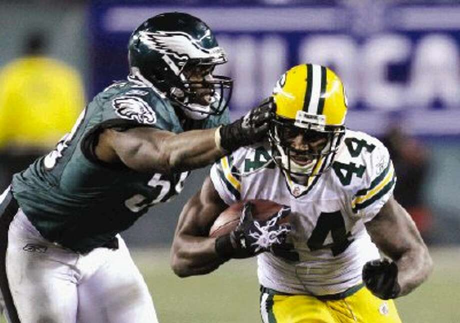 Philadelphia Eagles defensive end Trent Cole, left, reaches for Green Bay Packers running back James Starks (44) during the second half in Philadelphia Sunday. / AP2011