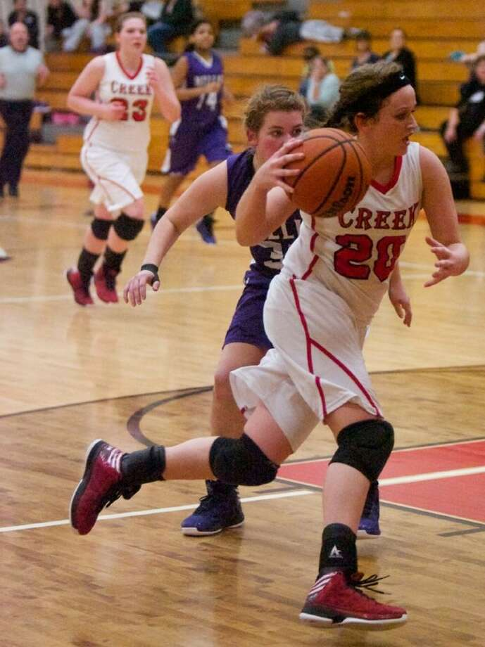 Caney Creek's Jessica Twardowski drives to the basket during Tuesday night's District 18-4A game against Willis at Caney Creek High School. Photo: Staff Photo By Eric Swist