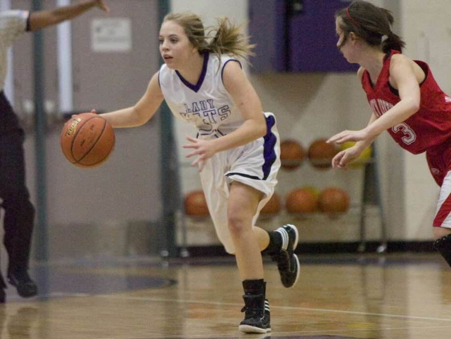 Willis' Morgan Ferguson dribbles past Caney Creek's Dee Tisdale during Tuesday night's game in Willis. Photo: Staff Photo By Eric S. Swist