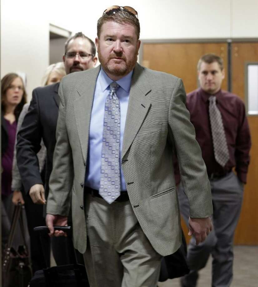 Defense attorney Daniel King leads his team to court for the third day of a preliminary hearing for Aurora theater shooting suspect James Holmes at the courthouse in Centennial, Colo., on Wednesday. Photo: Ed Andrieski / AP2013