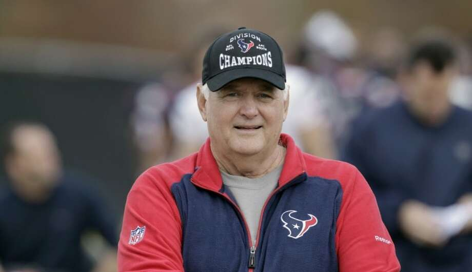 Houston Texans defensive coordinator Wade Phillips makes his way across the field to talk with the media after a practice Dec. 14 in Houston. Photo: David J. Phillip