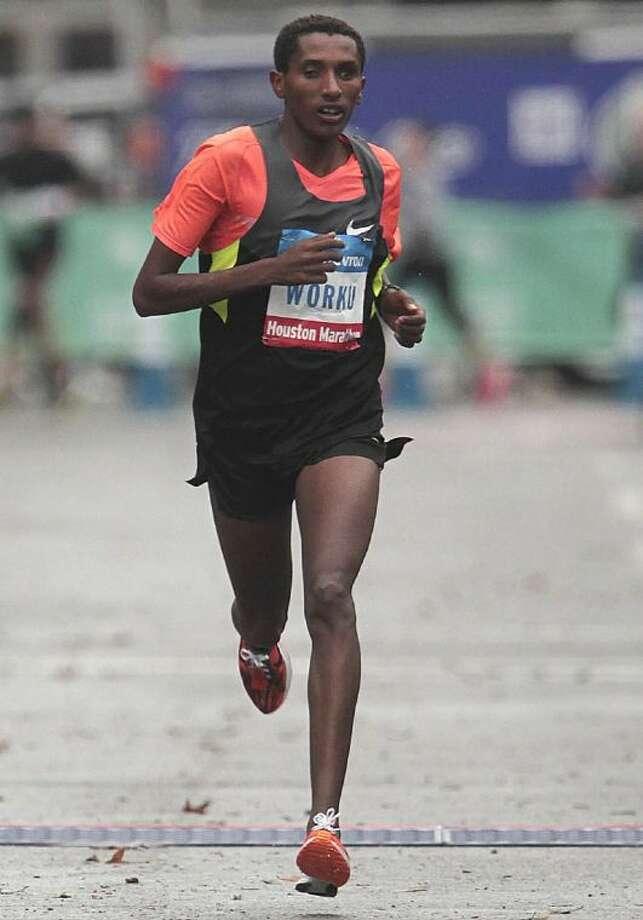 Bazu Worku, of Ethiopia, runs to the finish line to win the men's division of the Houston Marathon. Photo: James Nielsen / Houston Chronicle