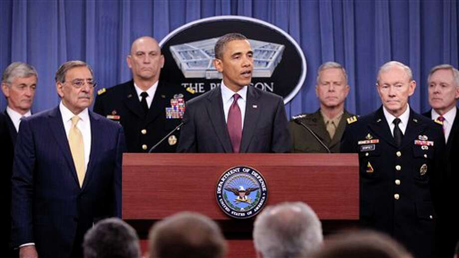 President Barack Obama speaks at the Pentagon, Thursday, Jan. 5, 2012, on the defense strategic guidance. From left are, Army Secretary John McHugh, Defense Secretary Leon Panetta, Army Chief of Staff Gen. Raymond T. Odierno, the president, Marine Corps Commandant Gen. James F. Amos, Joint Chiefs Chairman Gen. Martin E. Dempsey and Navy Secretary Ray Mabus. (AP Photo/Pablo Martinez Monsivais) Photo: AP Photo By Pablo Martinez Monsivais / AP2012