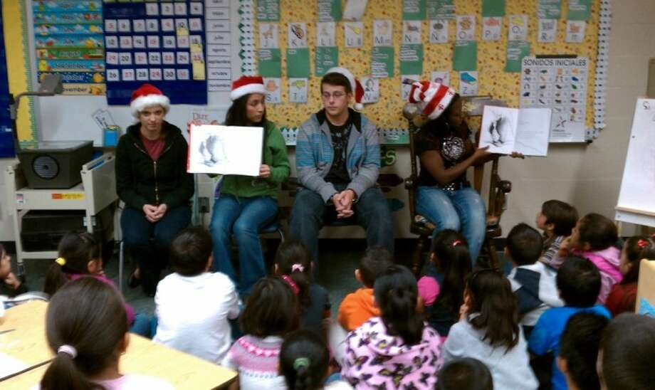 Willis High School Spanish Advanced Placement students visited CC Hardy Elementary Tuesday. The WHS Spanish AP students read stories to bilingual classes. All the students had fun playing literacy games and reading together. Shown left to right are Whitney Waters, Maribel Grimaldo, Dylan Harris and Kiki Hill.