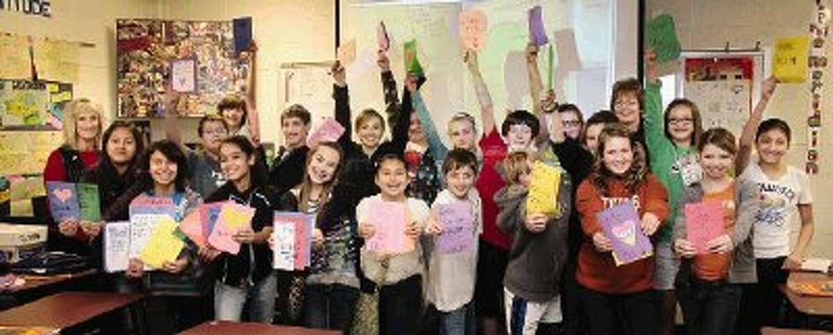 Students at Montgomery Middle School are participating in the Conroe Cookie Convoy by creating cards and notes of support for troops serving overseas.