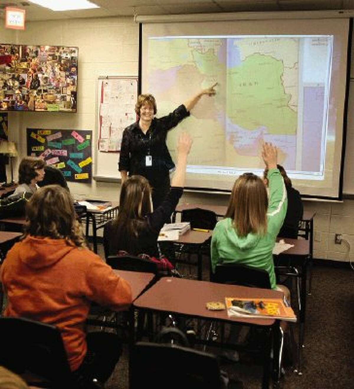 Students in Chris Corson's social studies class are learning about the Middle East by participating in a program paying tribute to U.S. servicemen and women serving in the region.
