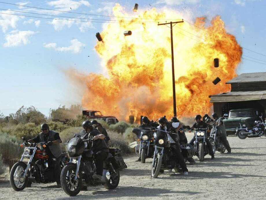 "FILE - In this file image released by FX, a scene is shown from the FX original series, ""Sons of Anarchy."" Television executives who spoke to the media recently about the tragic shootings in Newtown, Conn., and Aurora, Colo., say the events bothered them, but none offered concrete examples of how it is changing what they put on the air, or if that is necessary. FX President John Landgraf said he was in favor of further study about any correlation between entertainment and real violence. Landgraf pointed out that the zombie series ""Walking Dead"" and brutally violent ""Sons of Anarchy"" are both very popular in England and that country has far fewer gun murders than the United States. Photo: Prashant Gupta / A2011"