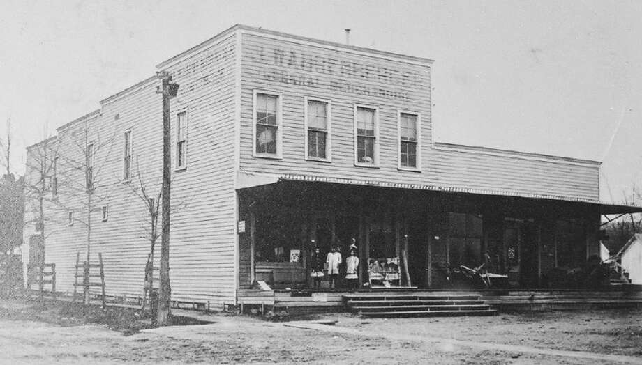 The original wooden J. Wahrenberger store circa 1900. At the time, it was said to be one of the largest mercantile stores in Texas.