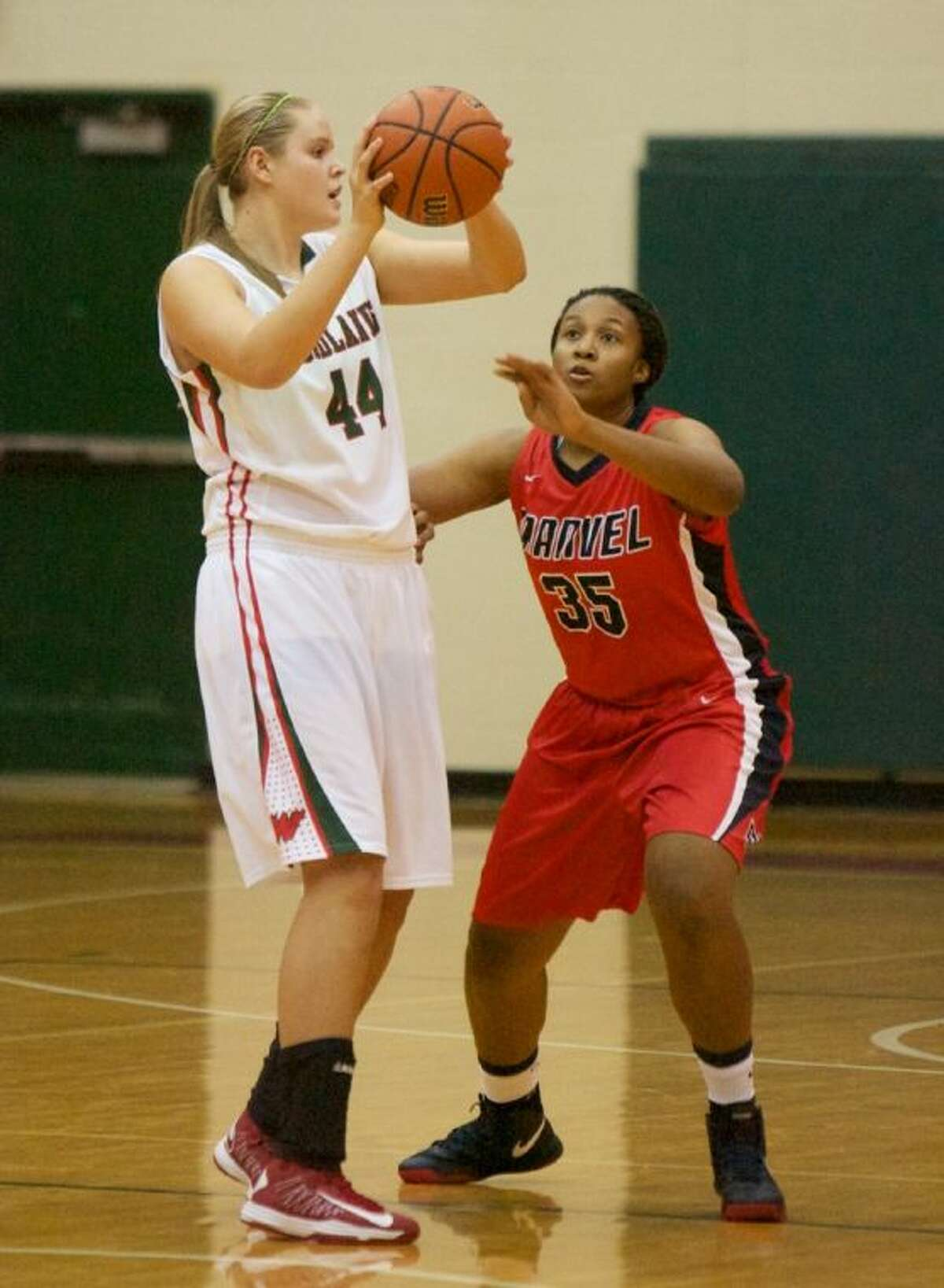 Kelsey Lang, left, and The Woodlands will try to stay unbeaten in District 14-5A when the Lady Highlanders play host to College Park tonight.