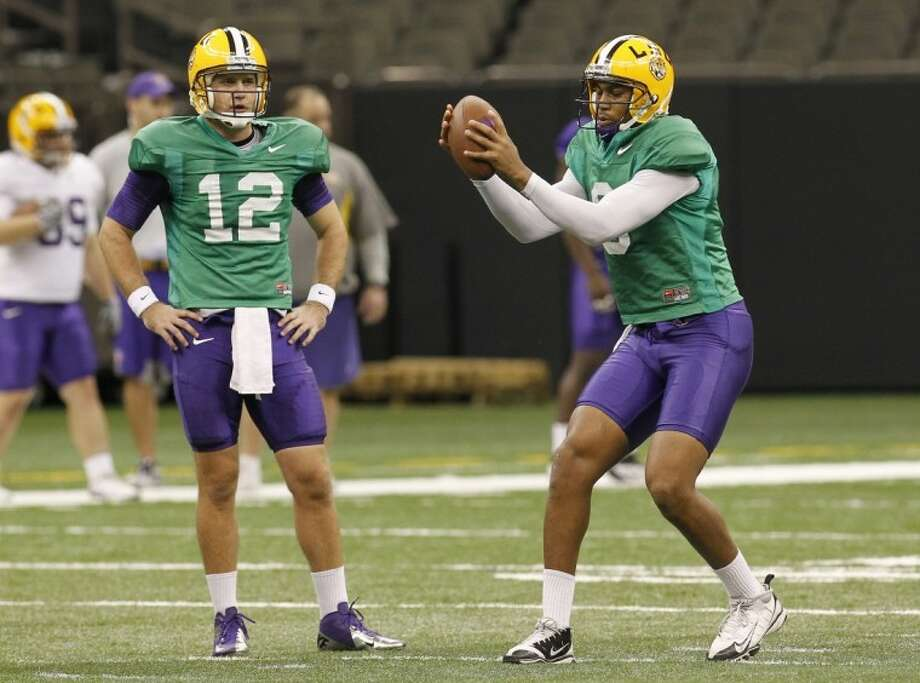 LSU quarterback Jarrett Lee, a Brenham High School grad, and Jordan Jefferson (9) warm up during practice for the BCS Championship at the Louisiana Superdome in New Orleans last Monday. LSU will face Alabama in the BCS Championship game on today. Photo: Bill Haber