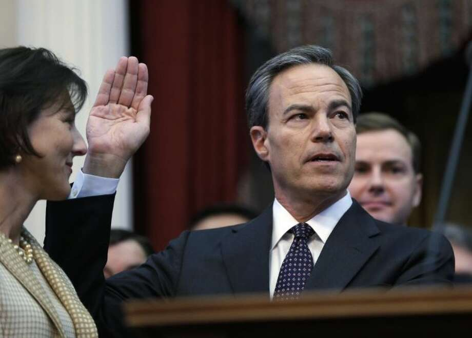 Rep. Joe Straus, right, R-San Antonio, with his wife Julie, left, is sworn in as speaker of the house by Chief Justice Wallace Jefferson, right, during the opening session of the 83rd Texas Legislature, Tuesday, Jan. 8, 2013, in Austin, Texas. Photo: Eric Gay / AP2013