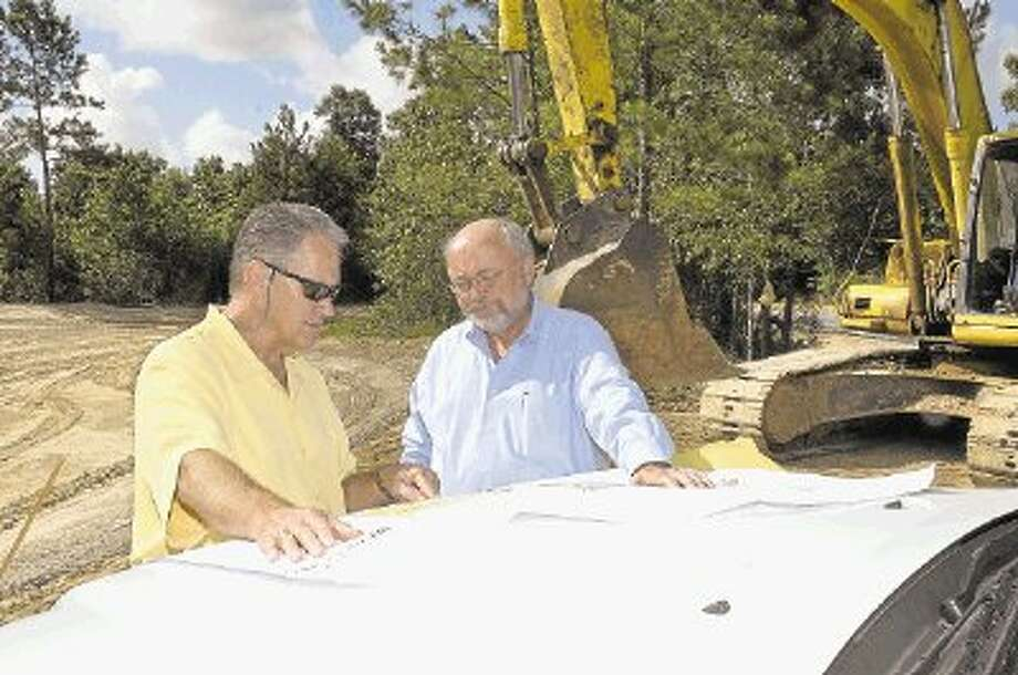 Virgil Yoakum, general manager for Woodforest, visits with Jim Wendt, with LJA Engineering and Surveying Inc., on the site of new construction in the community just north of The Woodlands. / @WireImgId=2551515