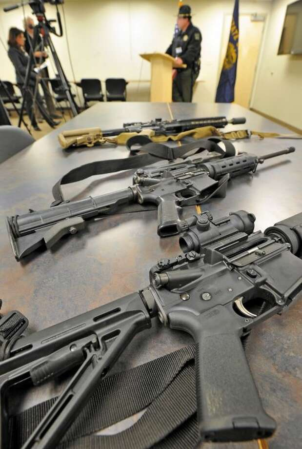 Jackson County (Ore.) Sheriff Mike Winters voices his opinion on President Barack Obama's gun control plans during a news conference Wed-nesday. President Barack Obama's proposed ban on new assault weapons and large-capacity maga-zines struck a nerve among rural lawmen and lawmakers. Photo: Jamie Lusch