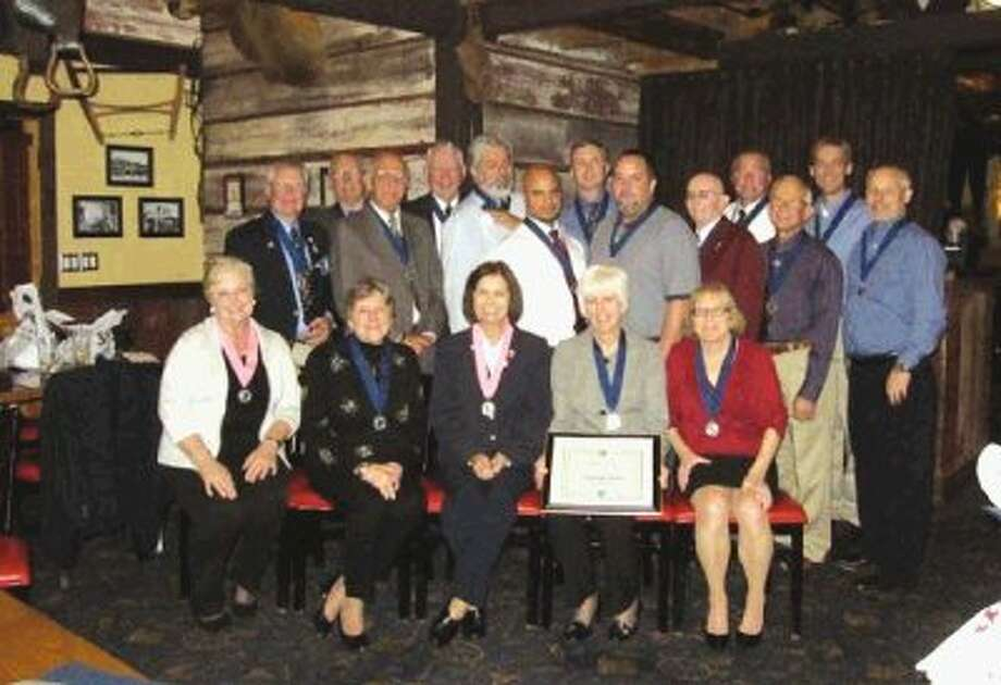 Conroe Noon Kiwanis Club members: Bottom (left to right) - Jamie DeGeorge, Cherie Angier, Ann Wilkins, Carolyn Price, Laura Harville; and top (from left) - Lynn DeGeorge, Jim Matthews, Bob Singleton, Mickey Deison, Mike Valdez, Javier Pena, Jon Buckholtz, Mike Cantu, Morris Straughan, Jerry Abbott, Dennis Umlang, Mike Riggens and Steve Reeves. Photo: Adubois