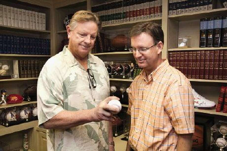 Legendary Houston Astros pitcher, color commentator and coach Larry Dierker, left, shows Pastor Mark Denison, founder of the Men's Power Lunch at First Baptist Church of Conroe, the secret to a split-finger fast ball.