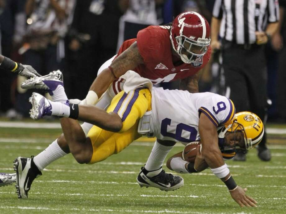 LSU quarterback Jordan Jefferson is tackled by Alabama's Mark Barron during the second half of the BCS National Championship Monday in New Orleans. Photo: Dave Martin