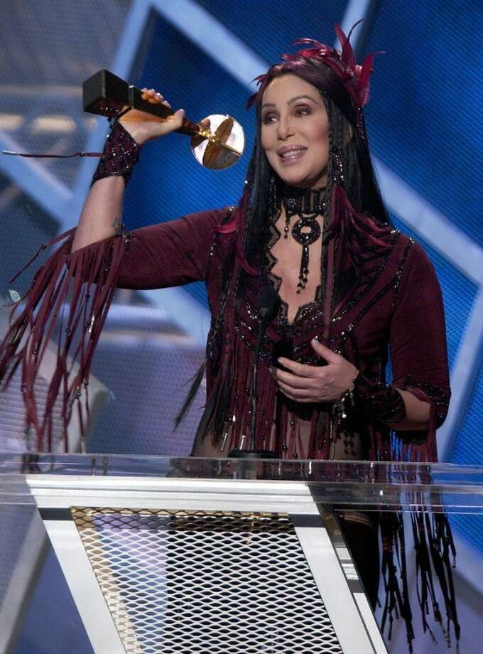 FILE - In this Dec. 9, 2002, file photo, Cher accepts a lifetime achievement award at the MGM Grand Hotel and Casino in Las Vegas during the Billboard Music Awards show. During the show Cher used the F-word. The Supreme Court will hear arguments Tuesday, Jan. 10, 2012, in a First Amendment case that pits the Obama administration against the nation's television networks. The Supreme Court is considering whether government regulators may still police the airwaves for curse words and other coarse content at a time when so many Americans have unregulated cable television, and the Internet is awash in easily accessible adult material. (AP Photo/Joe Cavaretta) Photo: AP Photo