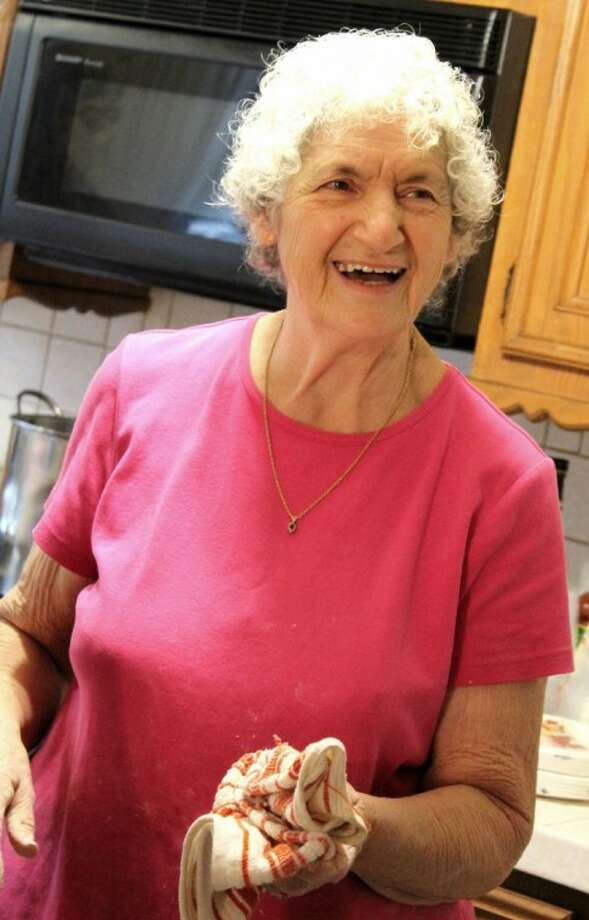 Julienne Righi Dempsey, of Conroe, fills hearts and tummies with her homemade Italian dishes, including caplith for Christmas.