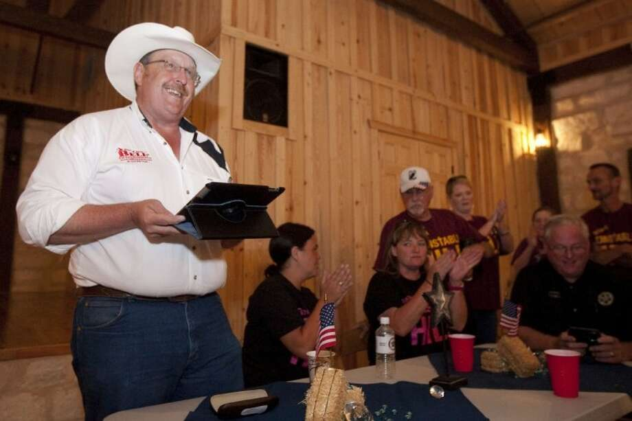Texas House District 3 candidate Cecil Bell reads out poll numbers an election watch party at Crystal Springs in Magnolia.