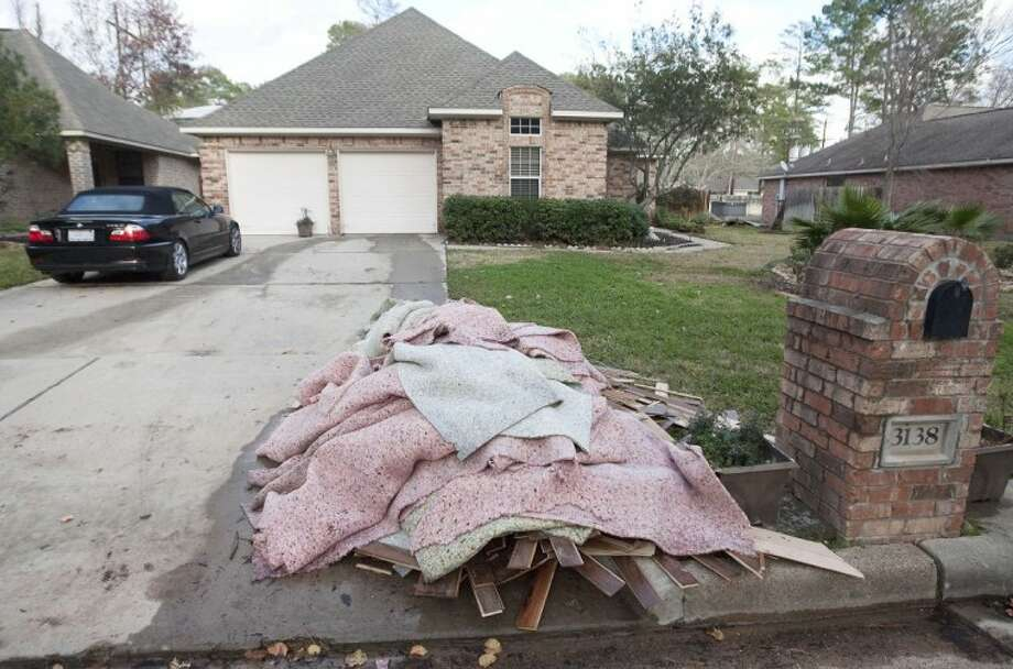 Home repair experts say minor flood damage can lead to major problems if not addressed - wet carpet should be removed and walls dried as quickly as possible. Photo: Karl Anderson