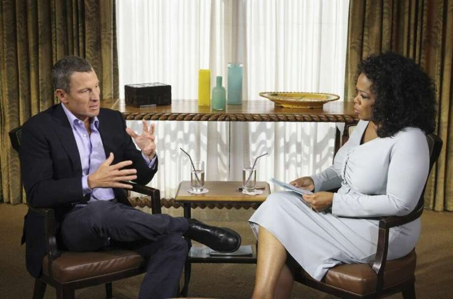 "This Monday photo provided by Harpo Studios Inc. shows talk-show host Oprah Winfrey interviewing cyclist Lance Armstrong during taping for the show ""Oprah and Lance Armstrong: The Worldwide Exclusive"" in Austin. The two-part episode of ""Oprah's Next Chapter"" will air nationally Thursday and Friday. Photo: George Burns / The Associated Press2013"