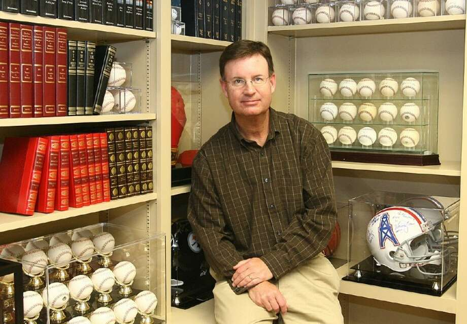 Pastor Mark Denison, of First Baptist Church of Conroe, is an avid collector of sports memorabilia.