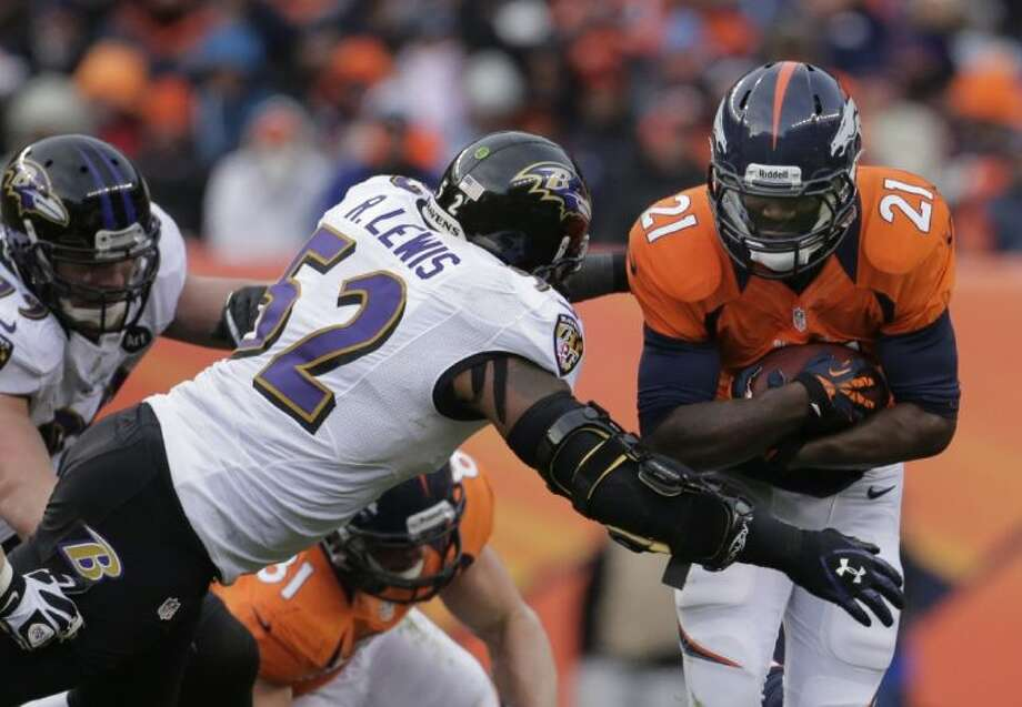 Baltimore Ravens inside linebacker Ray Lewis tackles Denver Broncos running back Ronnie Hillman in the second quarter of Saturday's AFC divisional playoff game in Denver. Photo: Charlie Riedel / AP2013