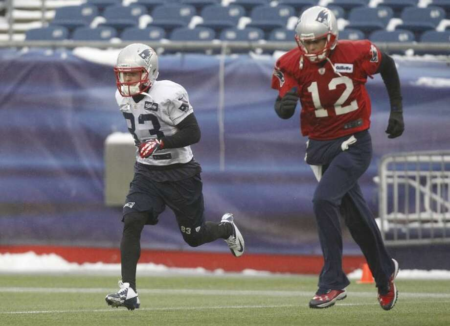 New England Patriots wide receiver Wes Welker and quarterback Tom Brady run during Wednesday's practice at the team's facility in Foxborough, Mass. Photo: Stephan Savoia / AP