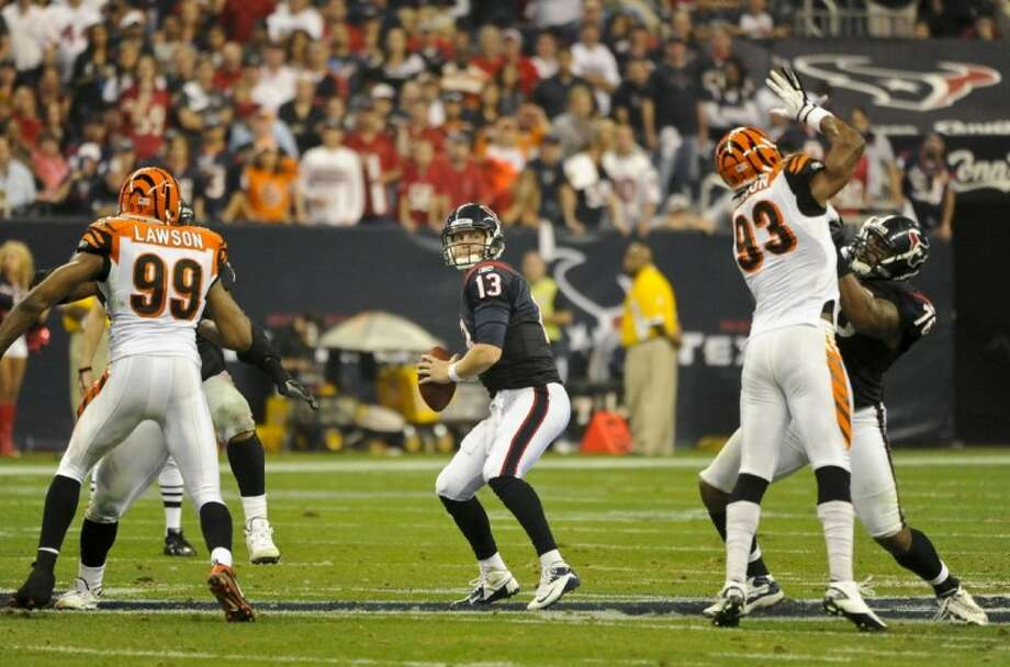 Houston Texans quarterback T.J. Yates sets to pass during an NFL wild card playoff game against the Cincinnati Bengals last Saturday in Houston. Photo: Dave Einsel