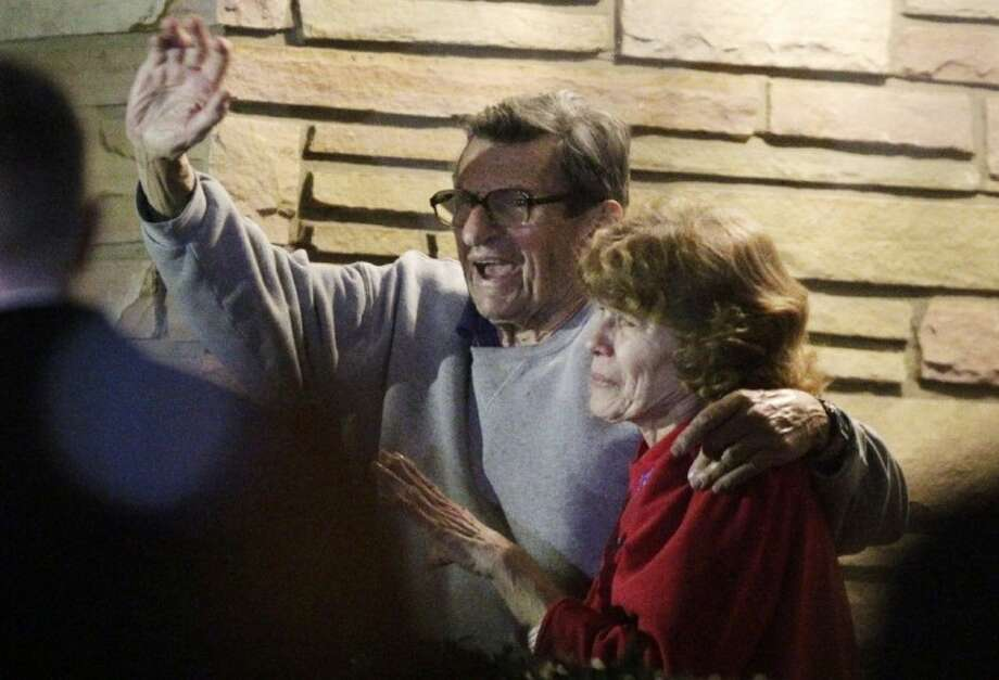 FILE - In this Nov. 9, 2011 file photo, former Penn State Coach Joe Paterno and his wife, Sue Paterno, stand on their porch to thank supporters gathered outside their home in State College, Pa. Paterno's family reported Friday that the long-time Penn State coach is back in the hospital to treat his cancer. Photo: Gene J. Puskar