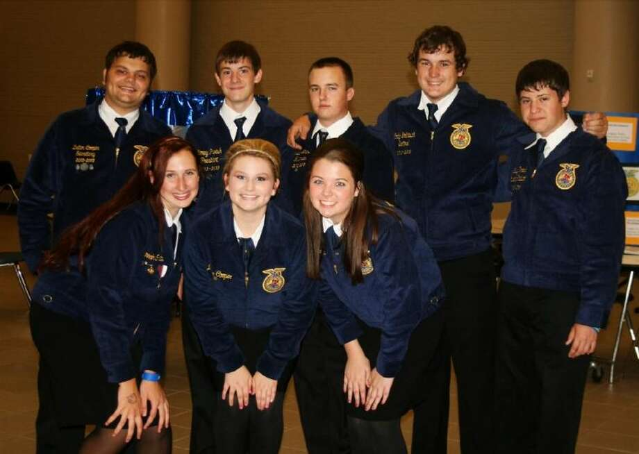 Caney Creek High School FFA Officers posed for a picture at a meeting.