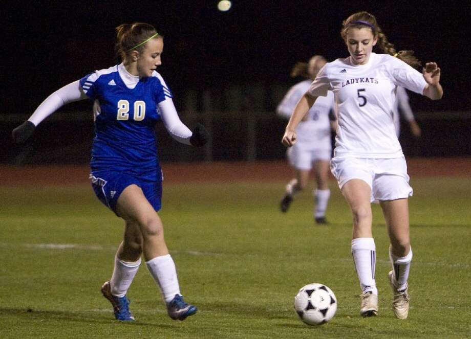 Willis' Jenny Corbett battles an Elkins defender for the ball during Friday night's non-district game in Willis. Photo: Staff Photo By Eric S. Swist