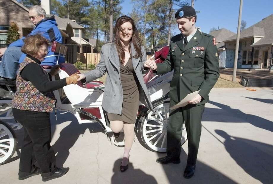 Spc. Chris Sanford and his wife, Christine, approach their new home donated by the Texas Sentinels Foundation on Saturday in The Woodlands. Sanford was injured by an improvised explosive device in Iraq in 2008. See more photos online at www.yourconroenews.com/photos.