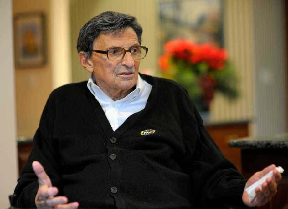 """In this photo taken Jan. 12, 2012, former Penn State football coach Joe Paterno gestures as while interviewed at his home in State College, Pa. In his first public comments since being fired two months ago, Paterno told The Washington Post he """"didn't know which way to go"""" after an assistant coach came to him in 2002 saying he had seen retired defensive coordinator Jerry Sandusky sexually abusing a boy Photo: John McDonnell"""
