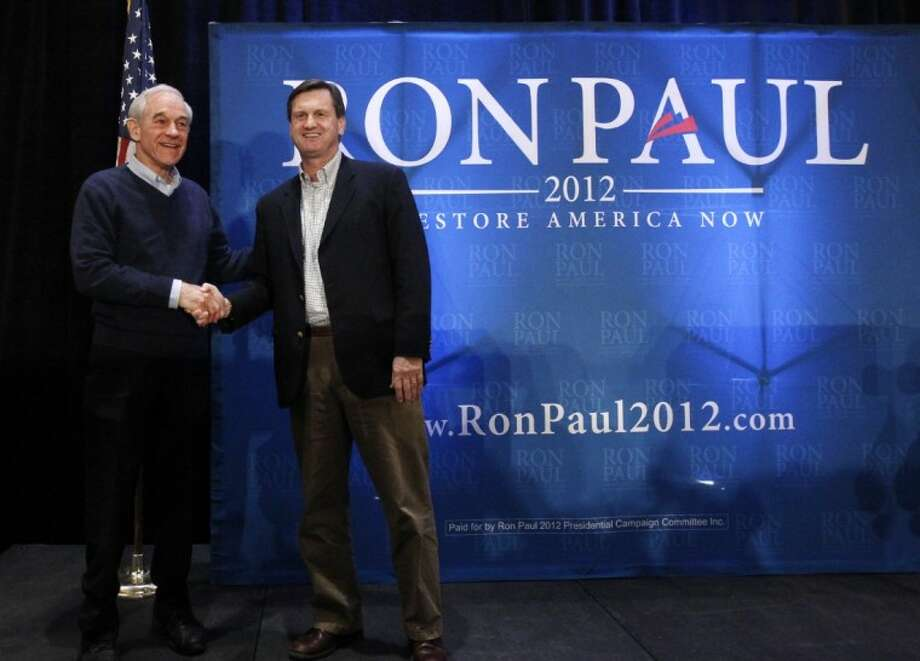 Republican presidential candidate, Rep. Ron Paul, R-Texas, is endorsed by South Carolina State Senator Tom Davis as he campaigns in Myrtle Beach, S.C., Sunday, Jan. 15, 2012. Photo: Charles Dharapak
