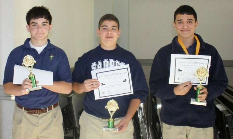 St. Anthony of Padua Catholic School middle school students recently competed in the area National Geographic Bee. Shown, from left, are Spencer O'Connor, second place; Charlie Scorpiniti, third place; and Collin Filley, first place. Filley will be testing for the next qualifying round which presents an opportunity to compete at the state level. Photo: Courtesy Photo
