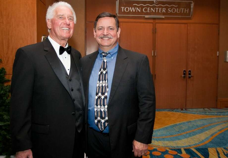 Outgoing chairman Roy Morton, left, stands for a photo with incoming Greater Conroe/Lake Conroe Area Chamber of Commerce chairman Charlie Irvine of Signs Etc., during Saturday night's Chairman's Ball event at the Woodlands Waterway Marriott.