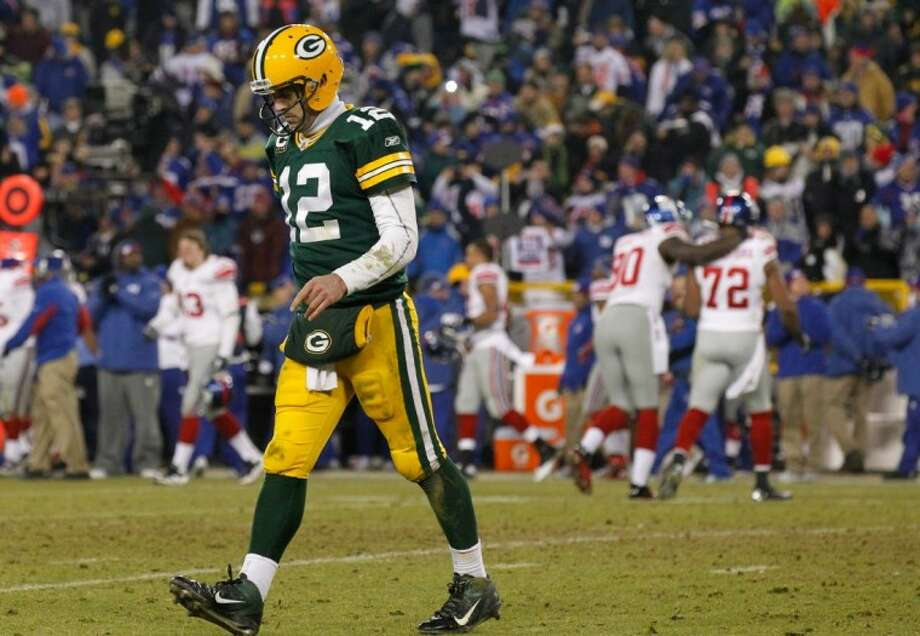 Green Bay Packers quarterback Aaron Rodgers walks off the field at the end of an NFL divisional playoff football game against the New York Giants Sunday, in Green Bay, Wis. The Giants won 37-20. Photo: Jeffrey Phelps
