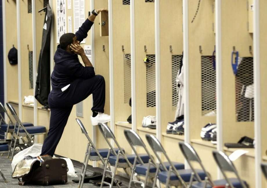 Houston Texans' Quintin Demps talks on the phone as he cleans out his locker Monday in Houston. The Texans season ended Sunday after losing to the Baltimore Ravens 20-13. Photo: David J. Phillip