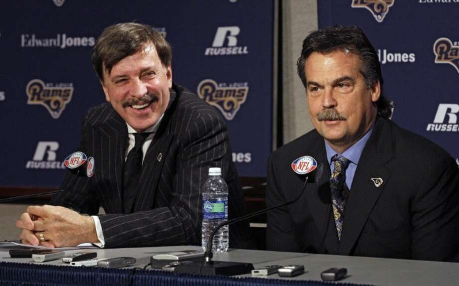 Jeff Fisher, right, shares a laugh with team owner Stan Kroenke during a news conference where he was officially introduced as the new head coach of the St. Louis Rams NFL team, in St. Louis, Tuesday. Photo: Tom Gannam